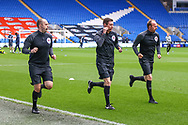 Today's referee Matthew Donohue warms up with the Assistant referees before the start of the EFL Sky Bet Championship match between Cardiff City and Millwall at the Cardiff City Stadium, Cardiff, Wales on 30 January 2021.