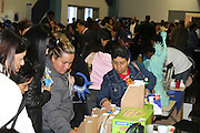Parents scan tables of information at the annual Parent Involvement Day. The celebration recognizes the role of parents as their children's first teachers and offers fresh approaches to supporting educational and personal growth. Grandparents were the main theme of this year's celebration, with information on the Grandparents Prep Academy being offered.<br />
