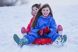 © Licensed to London News Pictures. 08/01/2021. Darlington, UK. Rosie,9, and Eliza,8, enjoy sledging in the snow at Hardwick County Park in Darlington.The Met Office issues yellow weather warning of snow and ice that will be affecting many parts of the UK for today.Photo credit: Ioannis Alexopoulos/LNP