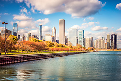Beautiful Chicago Skyline photo with Lake Michigan shoreline along Monroe Harbor and Grant Park in downtown Chicago. Colorful photo has HDR and toning applied. Image Copyright © Paul Velgos All Rights Reserved.