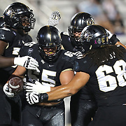 ORLANDO, FL - OCTOBER 03: Cole Schneider #65 of the Central Florida Knights celebrates after he scores a touchdown against the Tulsa Golden Hurricane at Bright House Networks Stadium on October 3, 2020 in Orlando, Florida. (Photo by Alex Menendez/Getty Images) *** Local Caption ***