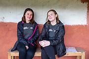 UK volunteers Polly Armstrong & Elinor Griffiths sitting outside their homestay. Devichou, Karyabinayak, Nepal. ICS / Restless Development volunteers in the Dakshinkali region of Nepal. (© Andy Aitchison / ICS)