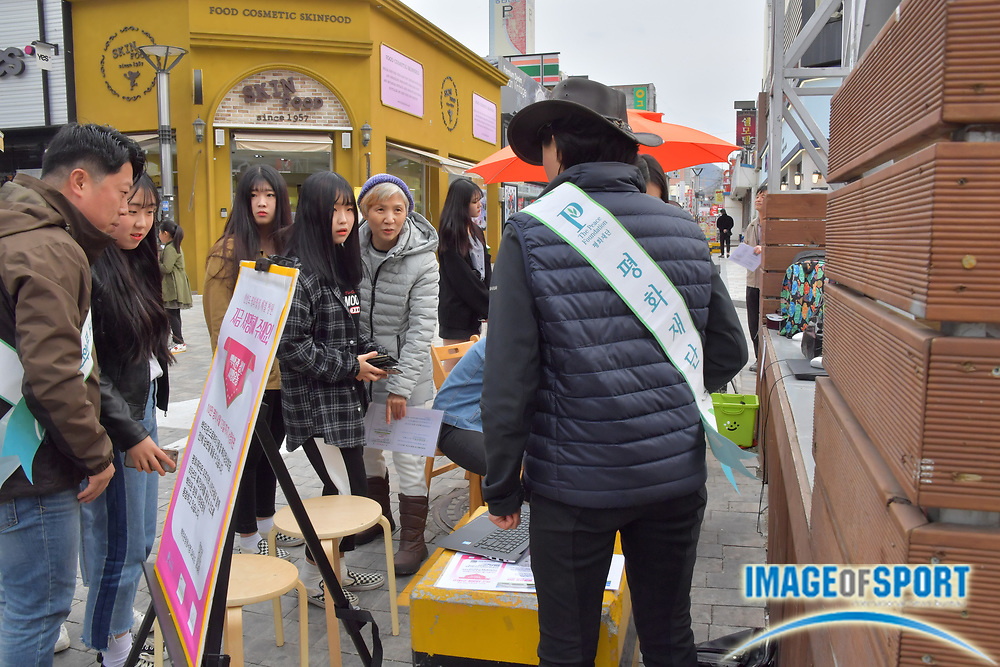 People sign a petition to United States president Donald Trump in downtown Chungju, North Chungcheong, South Korea, Sunday April 8 2018. The petition requests Trump to exercise leadership for peace and work towards a comprehensive and permanent peace solution in the Korean peninsula. (Jim Brown/Image of Sport)
