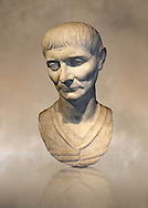 Roman portrait bust of a young man from 110 AD. In this portrait, the hairstyle and facial features are typical of the Trajan era of portraiture. The hairstyle is characterised by a slight central parting on the forehead . Inv 287, The National Roman Museum, Rome, Italy .<br /> <br /> f you prefer to buy from our ALAMY PHOTO LIBRARY  Collection visit : https://www.alamy.com/portfolio/paul-williams-funkystock/roman-museum-rome-sculpture.html<br /> <br /> Visit our ROMAN ART & HISTORIC SITES PHOTO COLLECTIONS for more photos to download or buy as wall art prints https://funkystock.photoshelter.com/gallery-collection/The-Romans-Art-Artefacts-Antiquities-Historic-Sites-Pictures-Images/C0000r2uLJJo9_s0