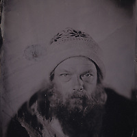 Tintype wetplate collodion plate made at Vine Street, Brighton. Windy, musician.