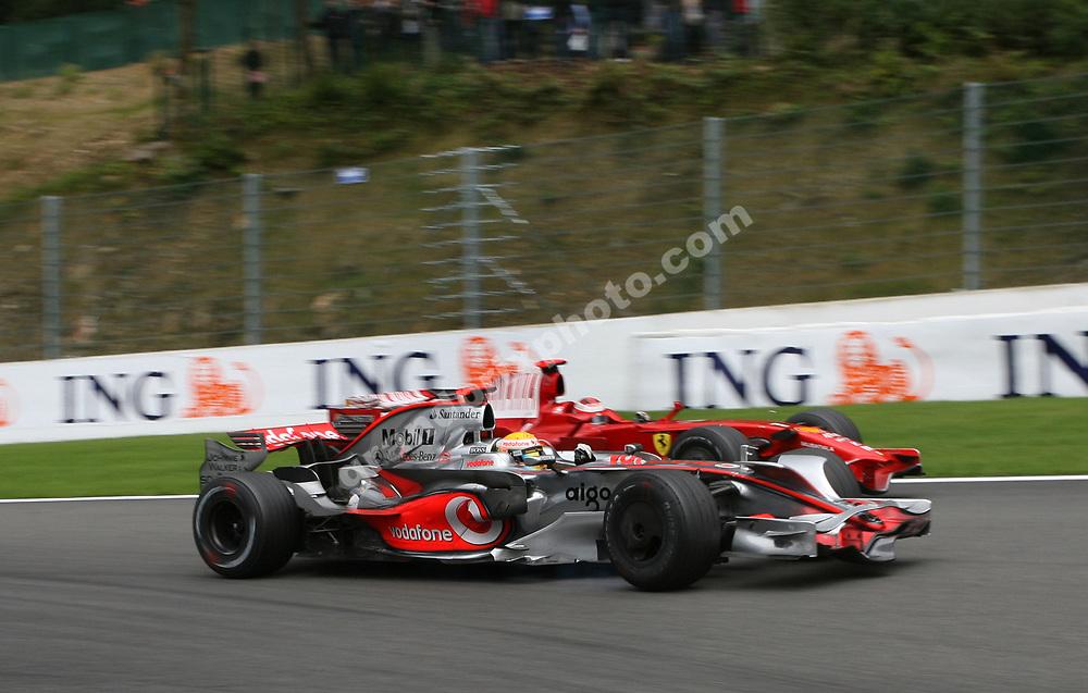 Lewis Hamilton (McLaren-Mercedes) takes the lead from Kimi Raikkonen (Ferrari) in the 2008 Belgian Grand Prix in Spa-Francorchamps. Photo: Grand Prix Photo