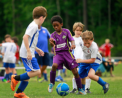 11 April 2015. Hammond, Louisiana.<br /> U9 New Orleans Jesters Elites, team purple play STYSA U10 Titans. Jesters emerge with a 5-1 victory in the first round of the Strawberry Cup hosted by the South Tangipahoa Youth Soccer Association (STYSA).<br /> Photo; Charlie Varley/varleypix.com