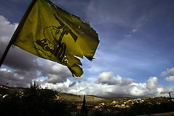 A tattered Hezbollah flag flies over Houla, Lebanon, March 10, 2005. Earlier in the week hundreds of thousands of pro-Syrian protesters answered the nationwide call from Hezbollah, the militant Shiite Muslim group, to demonstrate against foreign intervention.