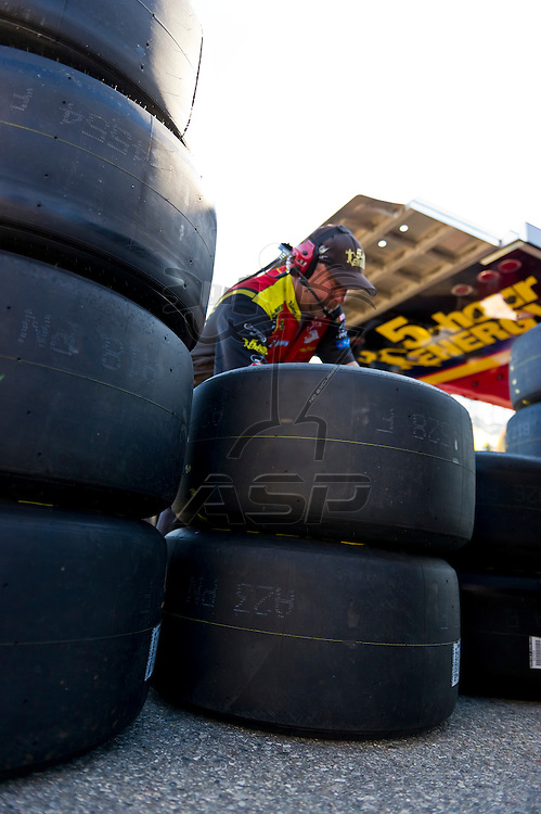 Brooklyn, MI - JUN 14, 2012:  Jeff Gordon's (24) team works in the garage during the first test session for the Quicken Loans 400 race at the Michigan International Speedway in Brooklyn, MI.