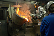 UK - Friday, Aug 01 2008:  Workers at the Whitechapel Bell Foundry in London pour molten metal into the cast of the 4th bell. (Photo by Peter Horrell / http://www.peterhorrell.com)