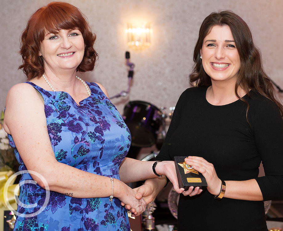 The Ability West Best Buddies Ball at the Menlo Park Hotel, Galway. Students from GMIT and NUIG buddy up with Ability West Service users for friendships that last a lifetime celebrated at this gala ball.<br /> NUIG's Adie Bourke receiving a special recognition award  from  Frances Murphy .  Photo:Andrew Downes, xposure.