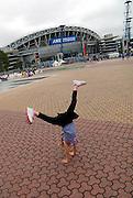 Child (6 years old) doing cartwheel outside Sydney Olympic Stadium. Sydney, Australia
