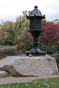 USA, Massachusetts, Boston. Boston Public Garden in autumn with a pumpkin
