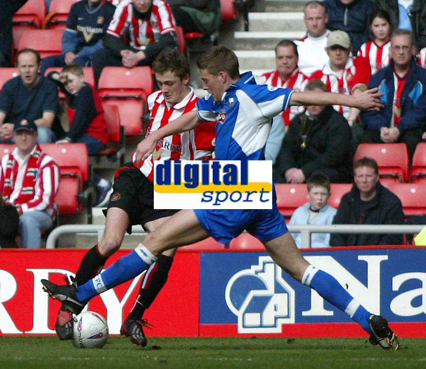 Photo. Andrew Unwin.<br /> Sunderland v Derby County, Nationwide League Division One, Stadium of Light, Sunderland 27/03/2004.<br /> Sunderland's George McCartney (l) is challenged by Derby's Rob Edwards (r).