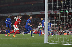 26 April 2016 London : Premier League Football : Arsenal v Leicester City :<br /> Olivier Giroud of Arsenal and City defender Robert Huth watch as the ball is deflected for the opening Arsenal goal.<br /> Photo: Mark Leech