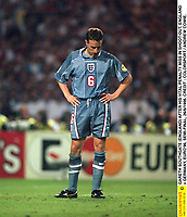 GARETH SOUTHGATE (ENGLAND) AFTER HIS VITAL PENALTY MISS IN SHOOT-OUT. ENGLAND v GERMANY, EURO'96, SEMI-FINAL, 26/6/1996. CREDIT : COLORSPORT / ANDREW COWIE.
