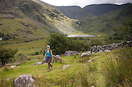 Hiker on the Kerry Way in McGillycuddy Reeks, Black Valley, County Kerry, Ireland
