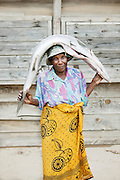 A woman carrying a big fish home in Morondava, Madagascar
