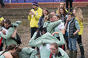 Greater London. United Kingdom, The Cambridge Women's square celebrate after winning both of the   Women's University Boat Race's , Cambridge University vs Oxford University. Putney to Mortlake,  Championship Course, River Thames, London. <br /> <br /> Saturday  24.03.18<br /> <br /> [Mandatory Credit  Intersport Images]