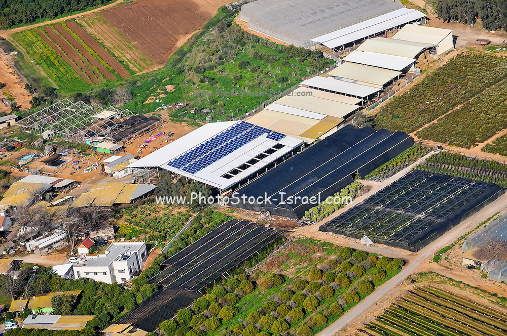 Aerial view of Sharon District, Israel from within a Cessna airplane agricultural sheds with solar panels