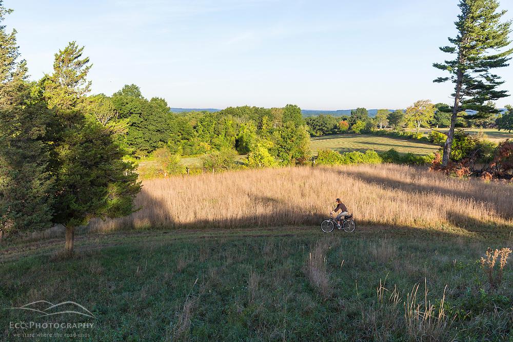 A woman biking on Sagamore Hill in Hamilton, Massachusetts.