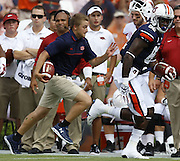 AUBURN, AL - AUGUST 30:  Wide receiver Melvin Ray #82 of the Auburn Tigers runs for a touchdown while the ballboy chases him down the sideline during the game against the Arkansas Razorbacks at Jordan Hare Stadium on August 30, 2014 in Auburn, Alabama.  (Photo by Mike Zarrilli/Getty Images)