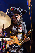 "3 August 2017 – Brooklyn, NY. Singer Nellie McKay opened for Béla Fleck and the Flecktones to a large crowd at the BRIC Celebrate Brooklyn! Festival at the Prospect Park Bandshell. The Flecktones' percussionist Roy ""Future Man"" Wooten on drums and a drumitar, a drum synthesizer, a keyed drum synthesizer shaped like a guitar."