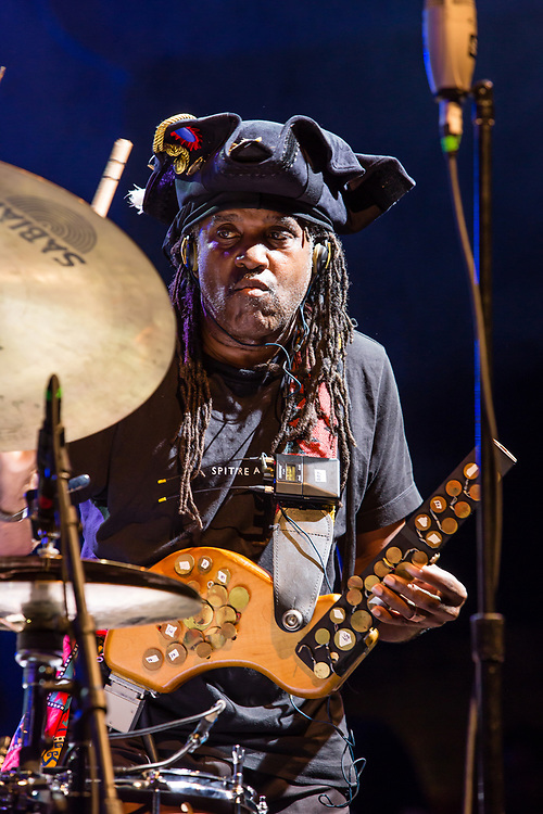 """3 August 2017 – Brooklyn, NY. Singer Nellie McKay opened for Béla Fleck and the Flecktones to a large crowd at the BRIC Celebrate Brooklyn! Festival at the Prospect Park Bandshell. The Flecktones' percussionist Roy """"Future Man"""" Wooten on drums and a drumitar, a drum synthesizer, a keyed drum synthesizer shaped like a guitar."""