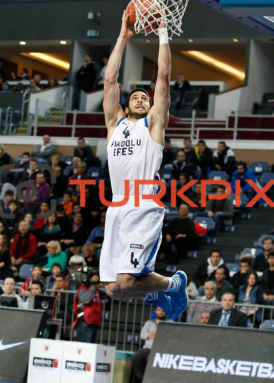 Anadolu Efes's Dogus Balbay during their Turkish Basketball League match Anadolu Efes between Mersin BSB at Sinan Erdem Arena in Istanbul, Turkey, Saturday, January 14, 2012. Photo by TURKPIX