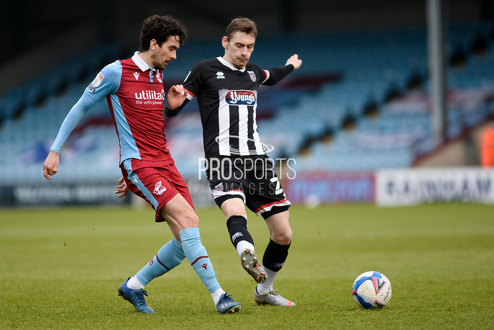 Scunthorpe United Alex Gilliead (8) plays a pass during the EFL Sky Bet League 2 match between Scunthorpe United and Grimsby Town FC at the Sands Venue Stadium, Scunthorpe, England on 23 January 2021.