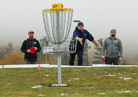 Alex Boulanger of Moultonboro and James Dearborn of Laconia watch while Beau Schofield of Penacook makes his throw from just outside of the 3rd tee box green during the Disc Golf Tournament at the Castle in the Clouds on Sunday.  (Karen Bobotas/for the Laconia Daily Sun)