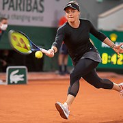 PARIS, FRANCE October 01. Ana Bogdan of Romania in action against Sofia Kenin of the United States in the second round of the singles competition on Court Philippe-Chatrier during the French Open Tennis Tournament at Roland Garros on October 1st 2020 in Paris, France. (Photo by Tim Clayton/Corbis via Getty Images)