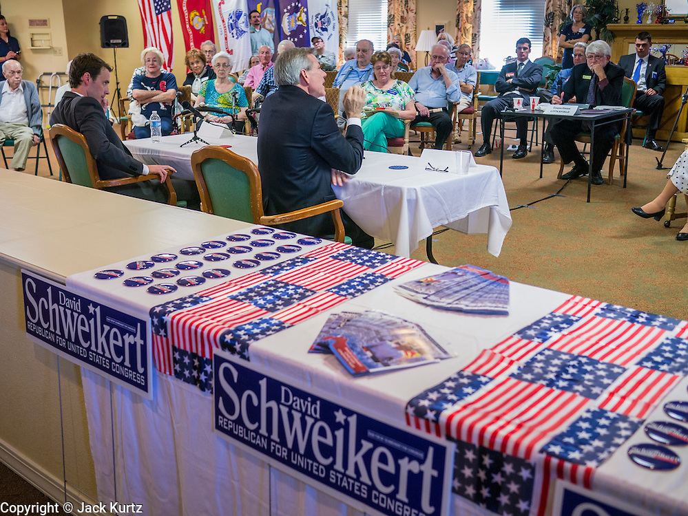 09 AUGUST 2012 - SCOTTSDALE, AZ:   Congressmen DAVID SCHWEIKERT (R-AZ), right, and BEN QUAYLE (R-AZ) sit together during a candidate forum at an adult assisted living facility in Scottsdale, AZ, Thursday. Republican Congressmen Ben Quayle and David Schweikert are facing each other in Arizona's Aug. 28 Republican primary. They are vying for the right to represent Arizona's 6th Congressional District. Both men are incumbent freshmen Congressmen. They were thrown into the same district during the redistricting process after the 2010 census. Both men are conservatives courting the Tea Party vote.  PHOTO BY JACK KURTZ