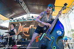 "Symphony Tidwell of ""The Living Deads"" on upright bass and vocals while performing at Main Street Station on Main Street during the 2015 Biketoberfest Rally. Daytona Beach, FL, USA. October 16, 2015.  Photography ©2015 Michael Lichter."