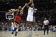 LeBron James of Cleveland shoots over Kasib Powell of Miami..The Miami Heat lost to the host Cleveland Cavaliers 84-76 at Quicken Loans Arena, April 13, 2008...