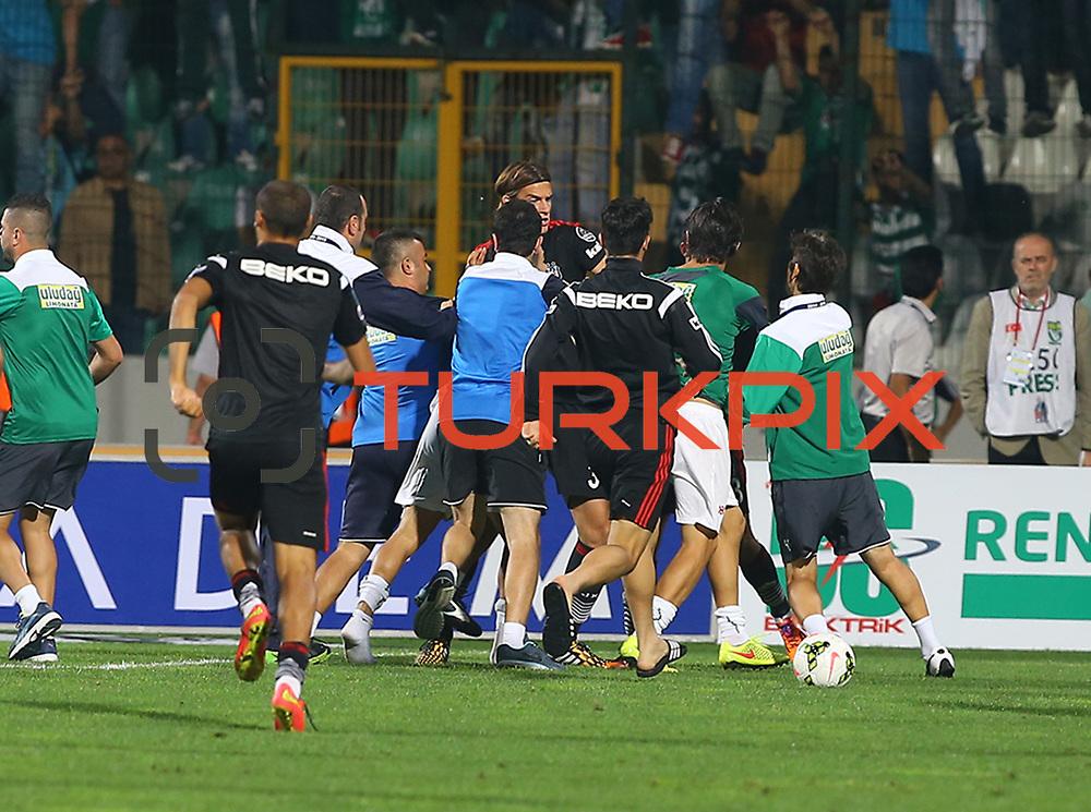 Bursaspor's and Besiktas's during the Turkish soccer super league match Bursaspor between Besiktas at the Ataturk Stadium in Bursa Turkey on Monday, 22 September 2014. Photo by TURKPIX