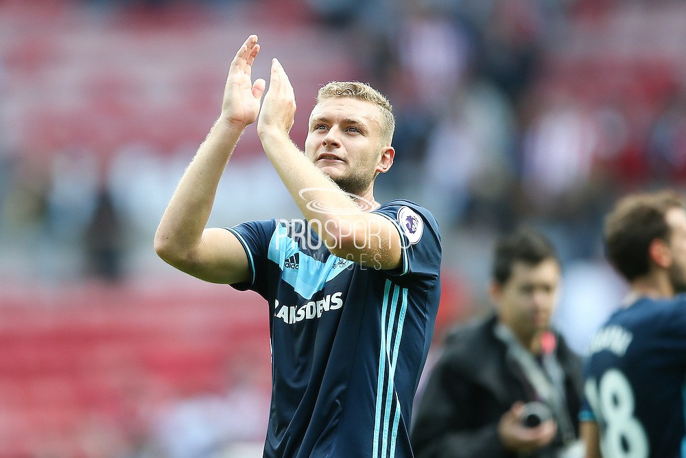 Middlesbrough defender Ben Gibson (6)  celebrates the victory after the final whistle during the Premier League match between Sunderland and Middlesbrough at the Stadium Of Light, Sunderland, England on 21 August 2016. Photo by Simon Davies.