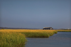 boathouse on the Shinnecock Bay in Southampton with tall grass