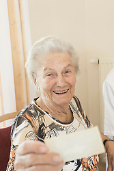 Senior woman watching photo in rest home, Bavaria, Germany