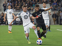May 9, 2018 - Los Angeles, California, U.S - Diego Rossi #9 of the LAFC battles for the ball with Jerome Thiesson #3 of the Minnesota United FC on Wednesday May 9, 2018, at the Banc of California Stadium in Los Angeles, California. LAFC defeats Minnesota United FC, 2-0. (Credit Image: © Prensa Internacional via ZUMA Wire)
