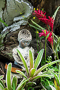 """Shrine statue at 1968 Byodo-In Temple, Valley of Temples Memorial Park, island of Oahu, Hawaii, USA. The peaceful Byodo-In Temple is in Valley of the Temples Memorial Park, at 47-200 Kahekili Highway, Kaneohe, on the island of Oahu. The Byodo-In Temple (""""Temple of Equality"""") was built in 1968 to commemorate the 100 year anniversary of the first Japanese immigrants to Hawaii. This Hawaii State Landmark is a non-practicing Buddhist temple which welcomes people of all faiths. The beautiful grounds at the foot of the Ko'olau Mountains include a large reflecting pond stocked with Japanese koi carp, meditation niches, and small waterfalls. Byodo-In Temple in O'ahu is a half-scale replica of the original Byodo-in Temple built in 1053 in Uji, Japan (a UNESCO World Heritage Site)."""