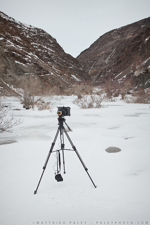 """Matthieu Paley's video camera. From Langar to Zan Kuk (""""woman's spring"""")...Trekking back down from the Little Pamir, with yak caravan, over the frozen Wakhan river."""