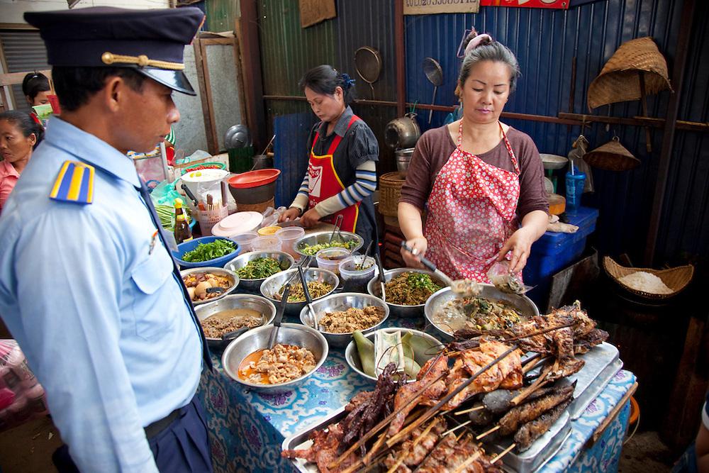 Vientiane, Laos. Food stall at morning market.