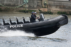 © Licensed to London News Pictures. 15/06/2016. London, UK. Police follow Vote Leave and EU remain campaigners as they converge on the Thames near Parliament. Photo credit: Peter Macdiarmid/LNP