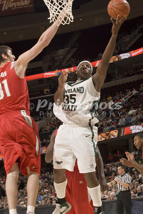 December 18, 2007: Cleveland State University's J'Nathan Bullock #35 goes to the basket against Ohio States Kosta Koufos #31 during the John McClendon Scholarship Classic in Cleveland, Ohio. Ohio State won the match 80-63. Michael Ciu.