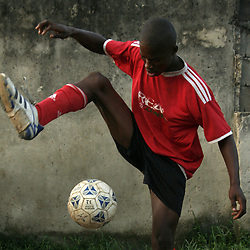 Many boys in Nigeria have a talent for playing football and want to play soccer for their national team and other clubs in the world. Tobias Adeyemi of Ogba location in Lagos State of Nigeria juggles the ball to showcase his skills at football. (Credit: Richard Mulonga/Twenty Ten/Africa Media Online)