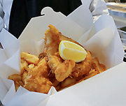 Fish and chips snack in cardboard box