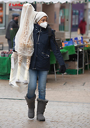 © Licensed to London News Pictures 12/04/2021. Bromley, UK. A woman carrying her new Giraffe. A busy Bromley High Street in South East London this morning as non-essential shops re-open today after four months closed because of the Coronavirus outbreak. Photo credit:Grant Falvey/LNP