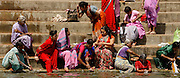 """Varanasi, India. Friday 16 March.Varanasi, one of the holiest cities in India is situated on the western bank of the Ganges River and attracts Hindu pilgrims from across the Globe who come to the Varanasi ghats (steps) to bathe in the waters of Ma Ganga..  Alongside the bathing ghats are also """"burning ghats"""" where bodies are cremated in public, the ashes then given to the waters..     The Ganges river is 1557 miles long and stretches from the Himalayas to the Indian Port of Calcutta, supplying water to one twelth of the worlds population. ."""