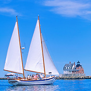 Schooner passing the Breakwater Lighthouse in Penobscot Bay. Rockland, Maine